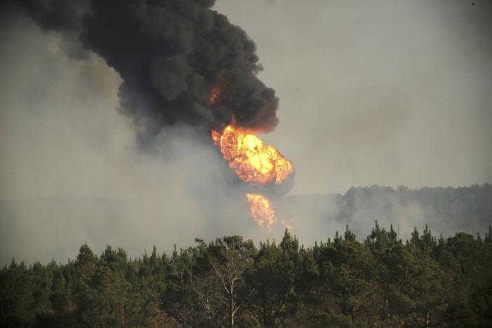 Flames shoot into the sky from a gas line explosion in western Shelby County, Alabama, U.S., October 31, 2016. REUTERS/Marvin Gentry